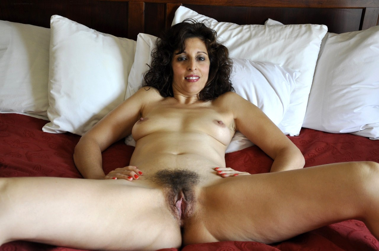 Brunette mature babe in jeans skirt exoposes ass and hairy pussy