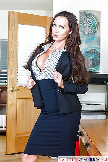 Nikki-Benz-solo-girl-NB-displaying-massive-tits-at-work-in-office-01.jpg