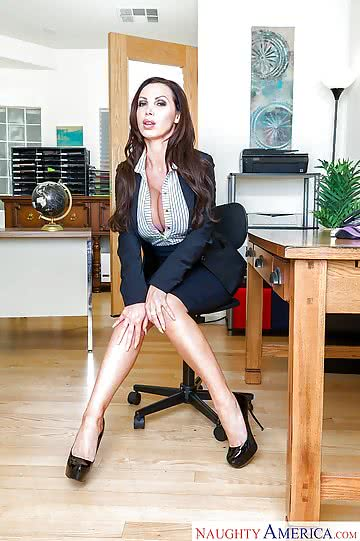 Nikki-Benz-solo-girl-NB-displaying-massive-tits-at-work-in-office-02.jpg