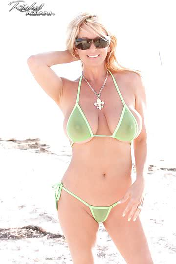 Rachel-Aziani-Busty-blonde-MILF-RA-strips-bikini-at-the-beach-to-pose-in-the-sand-01.jpg