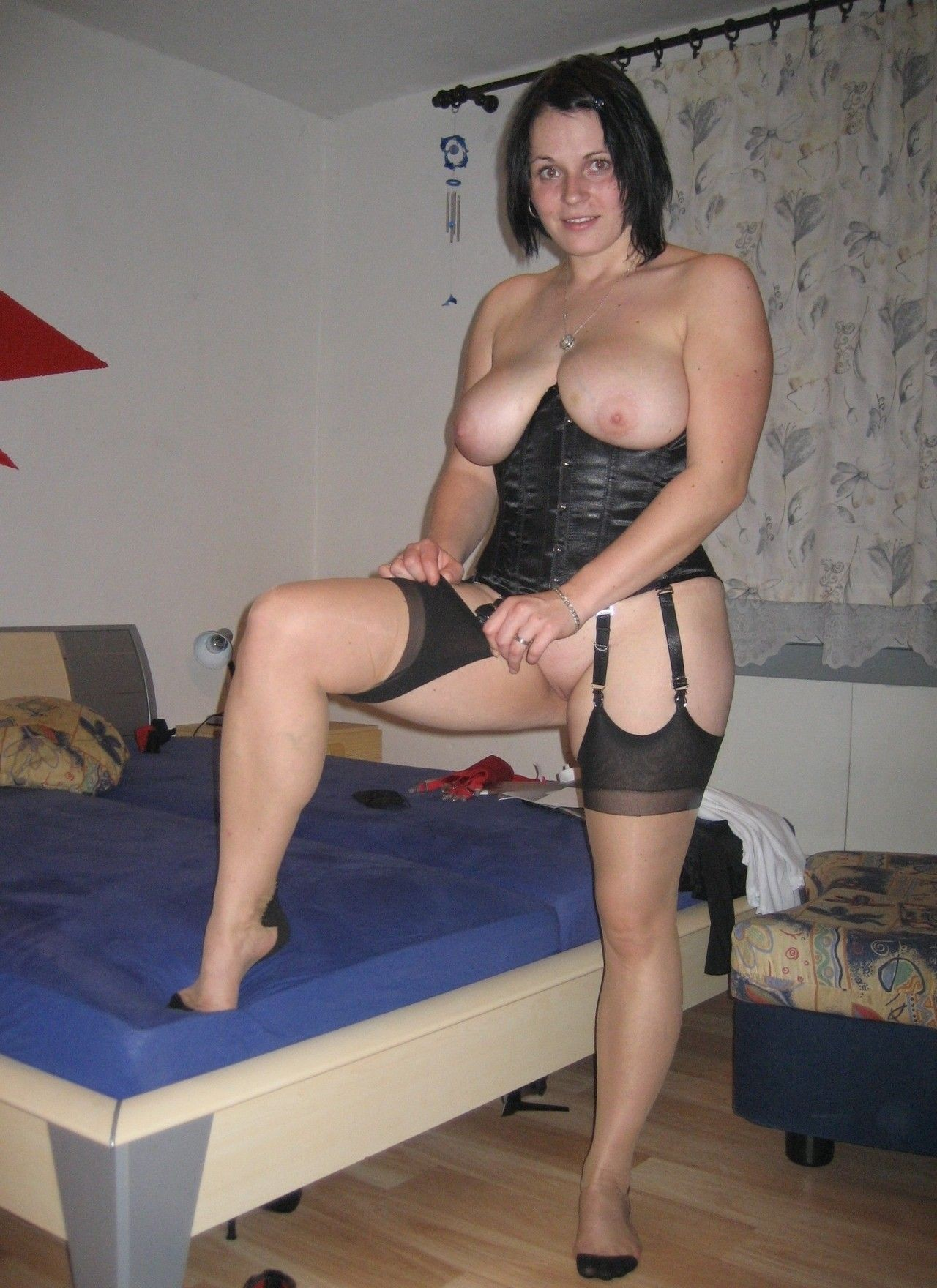 Chubby-wife-in-corset-and-nylons-getting-dressed.jpg