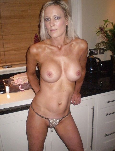 Hot-blonde-wife-shot-wearing-nothing-but-thong.jpg